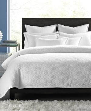 White quilt bedding.