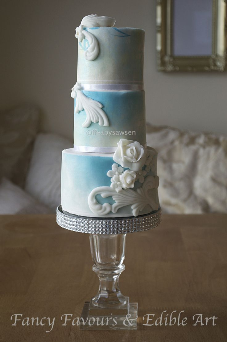 Sky blue mini tiered cake with white bas relief | Fancy Favours & Edible Art -- #vintage #skyblue #blue #basrelief #roses #white #elegant #cake #occasion #vintage #ornate #baroque #rococo #flowers #customcake #mini #tiered #tall #wedding #weddingcake