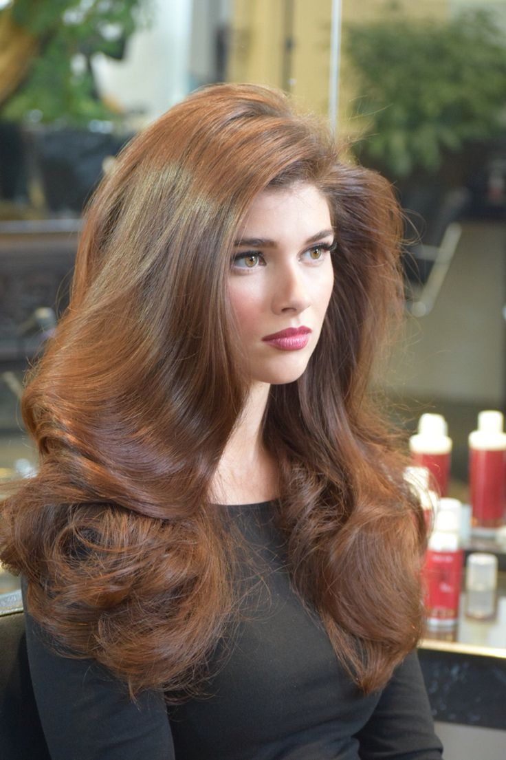 This hairstyle that I created for a photoshoot reminds me of the glamour of old Hollywood:  voluminous, bouncy waves are a perfect red carpet look. As always, hydrated and shiny hair with major lift and volume is a timeless beauty accessory.