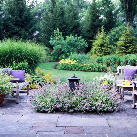 Soften the Edges of Your Patio with a Flowering Border & Blue stone