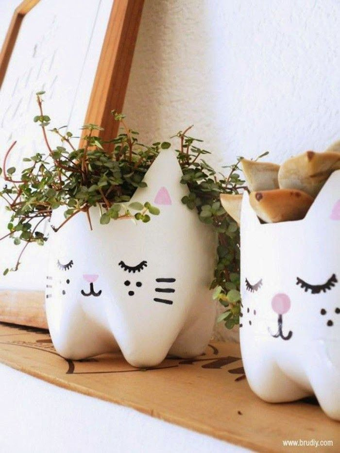 Poppytalk: Kitty Soda Pop Bottle Planters Cut off the bottom of a plastic soda bottle, download the kitty face template, and you're set.  From BruDiy.