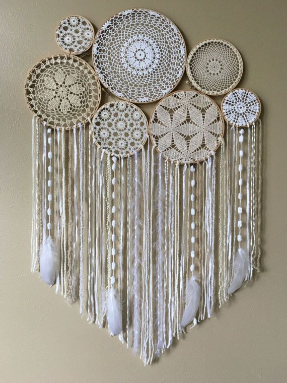 This gorgeous dreamcatcher wall hanging would be the perfect backdrop for your bohemian wedding, or hanging above your bed, sofa, or mantel, or in your boho nursery! Dream catchers are said to protect the sleeping individual from negative dreams, while letting positive dreams through.  • DETAILS: This dreamcatcher wall hanging has a 10 inch, two 8 inch, two 6 inch, and two 4 inch wood embroidery hoops. The centers are vintage crocheted doilies and lace, in whites and creams. The tail is a…