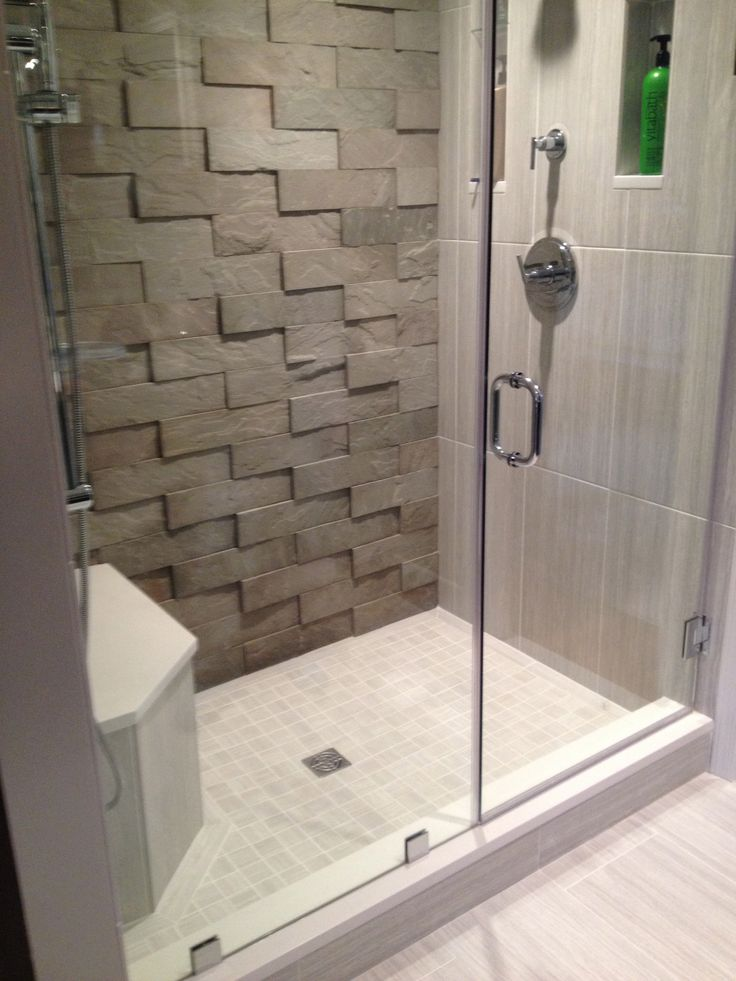 This bathroom features our large Vtile in sandstone grey