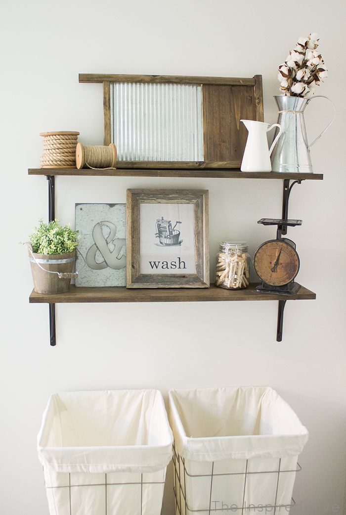 DIY rustic industrial laundry room shelving idea. Love those laundry hampers!