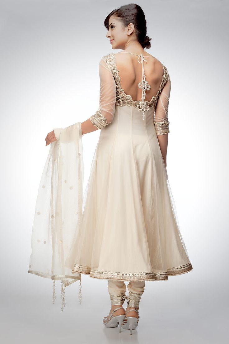 Cut a celestial figure in this pristine off-white anarkali suit which is complemented by zardozi work and silver lining. The transparent dupatta with glittery polka dots recites a poem of the star-studded sky. Shop online at www.satyapaul.com and Join our facebook page at www.facebook.com/SatyaPaulIndia