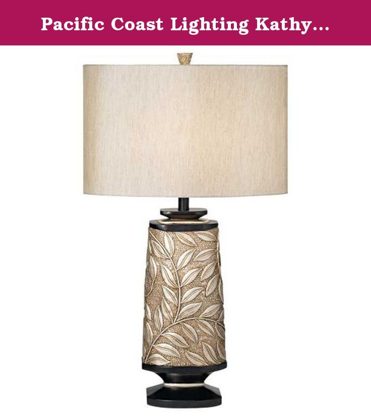 Pacific Coast Lighting Kathy Ireland Essentials Marrakesh Garden Table Lamp. Transitional style table lamp in silver leaf finish. Oval-shaped Bavaria fabric shade in cream. Requires one 150-watt medium base bulb. Shade dimensions: 18L x 18W x 11H in.. Overall dimensions: 18W x 33H in.