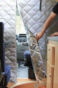 Fiamma thermal wall panel. Separating the cabin from the living area of the van with an insulated privacy curtain offers greater privacy and it protects the interior from the heat entering thru the large windscreen, but also increases the efficiency of the van's air conditioning. | CargoVanConversion.com