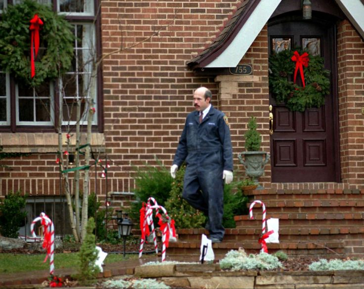 A Boulder Police Department detective leaves the home of John and Patricia Ramsey in this Jan. 3, 1997, Boulder, CO