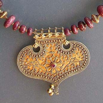 by Michael Beste | Necklace detail; an antique gold pendant from Gujarat (India) has been combined with old gold beads from Karnataka (South India) and rubies. | Sold