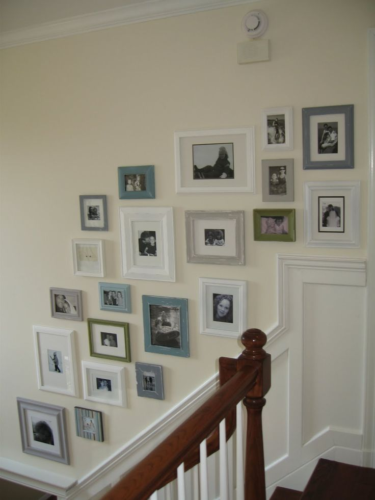 Gallery wall on stairwell - like the variation in frame colors, a slight eclectic feel but still tied together