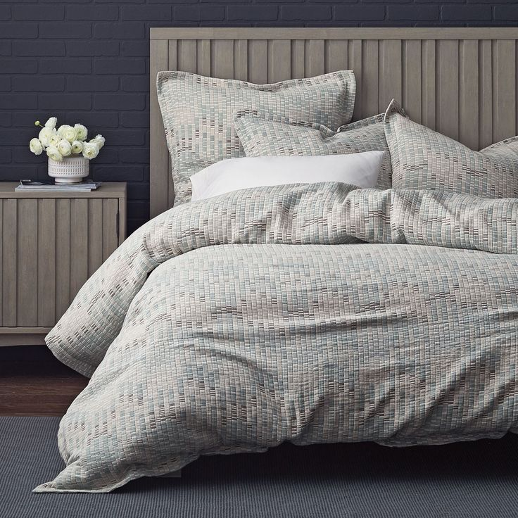 This contemporary duvet cover brings texture to the bed. Jjacquard woven of yarn-dyed cotton in a palette of soft sea-glass hues.