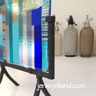 """blue sculptural work in steel stand 20cms wide and 40cms tall, titled """"Encounter Bay"""" created by Jenie Yolland"""