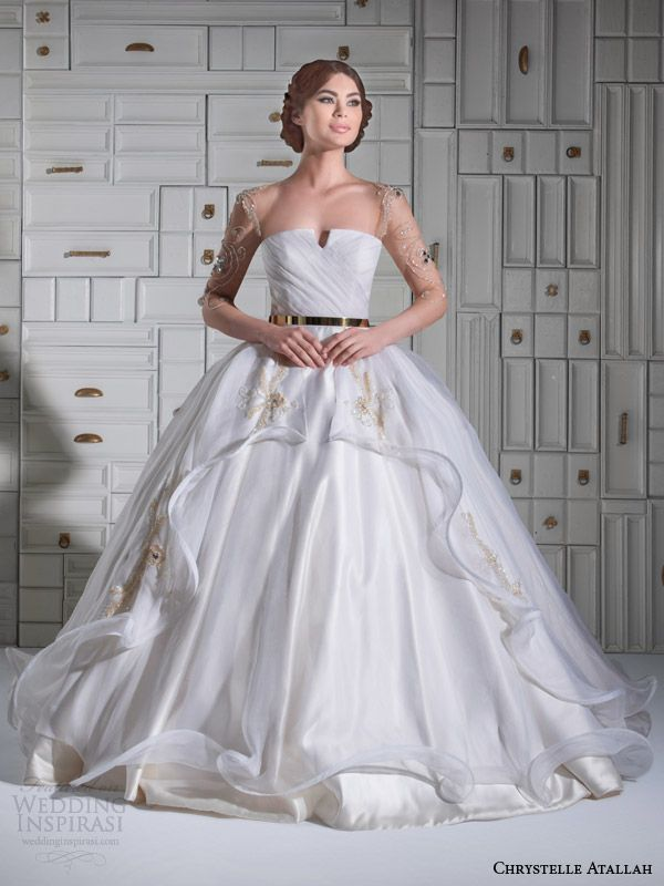 Chrystelle Atallah Style Laya      Satin ball gown with gold and silver embroidered Organza overskirt. Gown has illusion sleeves and back, richly gold and silver embroidered and jewel beaded.