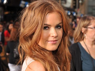 Auburn-haired actress Isla Fisher's long locks have a glamorous hint of red.   - MarieClaire.com