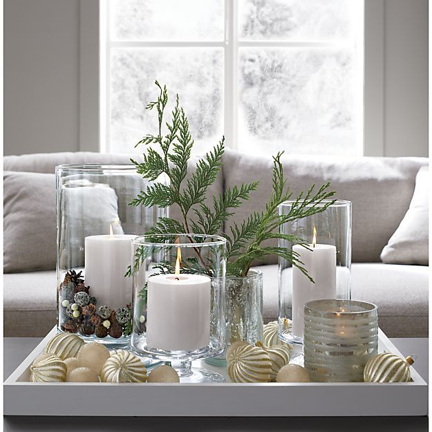 A Crate and Barrel classic, these handcrafted glass hurricanes, look as beautiful reflecting candlelight as they do filled with twinkling garlands or terrarium plantings. Each is handmade in crystal-clear glass by artisans at a European glass collective dating back to 1923.