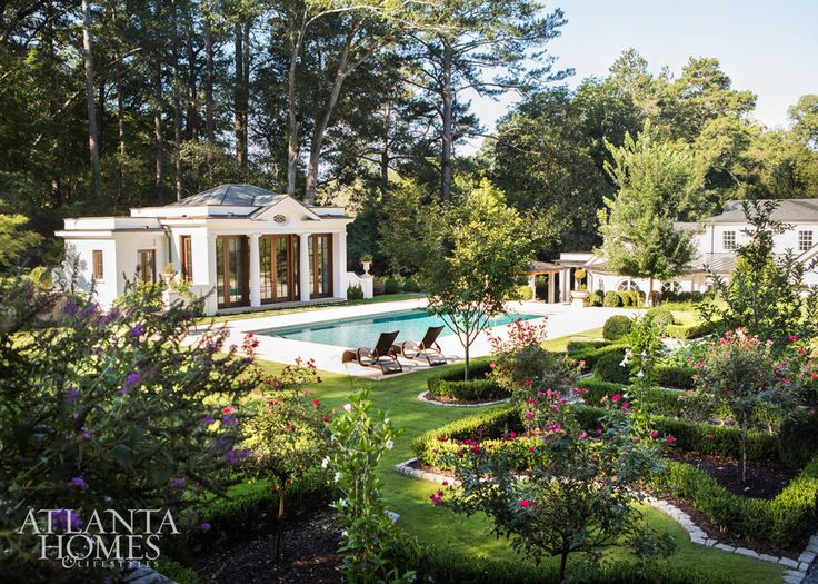 The backyard features resort-like amenities: a fire pit, tennis court, bocce lawn, pool and Spitzmiller & Norris–designed pool house.