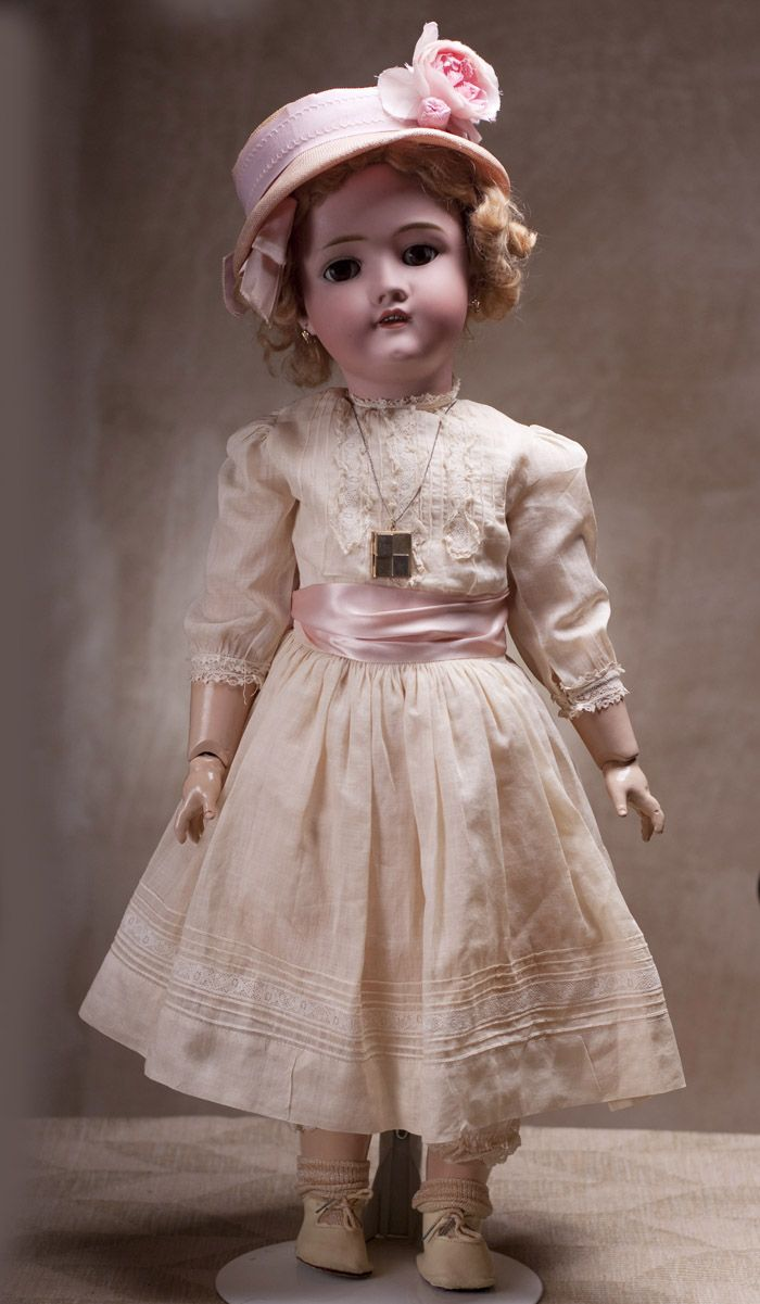 """Antique German Bisque child doll by Kley & Hahn. Ball jointed, open mouth, 26"""", which is large for a child doll."""
