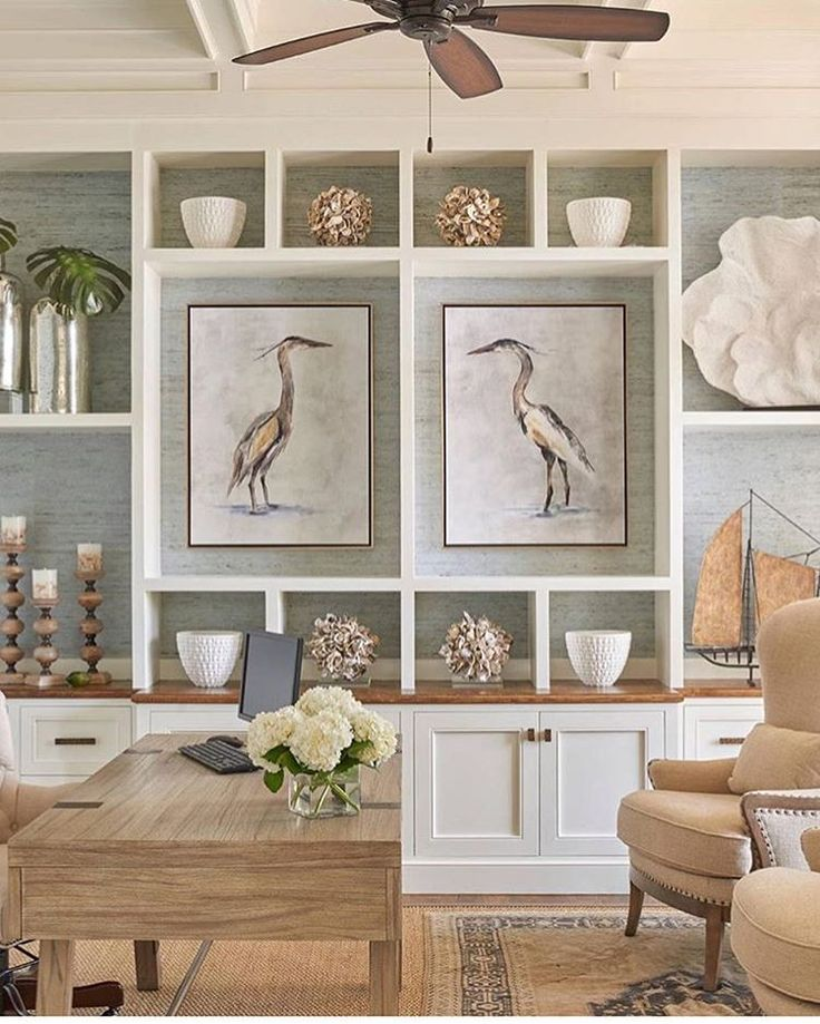 This @coastalinteriors shot has us all . Layered rugs, grasscloth backed  shelves, and