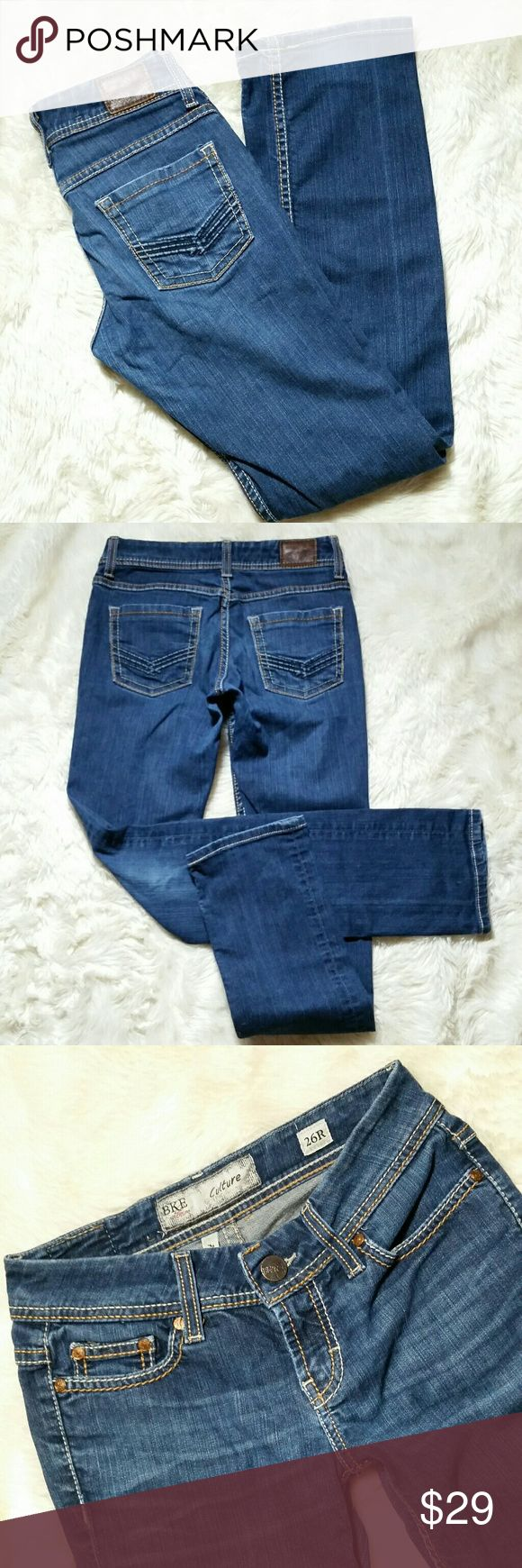 """BKE Straight Leg Culture Buckle Jeans Size 26 BKE Straight Leg Culture Buckle Jeans Size 26. Dark blue wash with embossed and stitched chevron arrow back pockets. Button and zip fly. Soft stretch denim made up of a tri blend of 92% cotton, 7% polyester & 1% spandex.  Preowned in good condition with no rips, holes, tears or stains. Hems show very minor distressing and fading.   Waist 14"""" Rise 7.5"""" Inseam 31"""" Leg Opening 7"""" BKE Jeans Straight Leg"""
