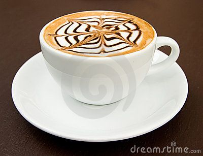 A cup of latte-art hot coffee by Prapass Wannapinij, via Dreamstime