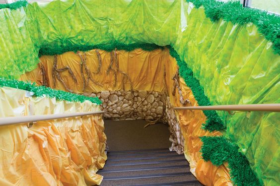 Stairwell: Kids will feel like they are really heading into a cave as they go down the stairs and transition through layers of the earth! #cavequest: