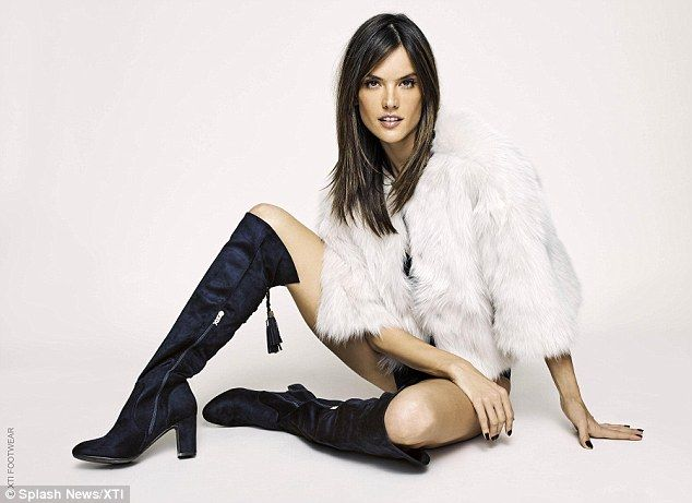 Leggy lady: Layering a chic fur jacket on top to make the look more demure, the model was seen posing in racy knee-high boots - to show off her long legs in all their glory