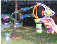 Verão totalmente automático arma de bolha transparente ventilador da bolha máquina de bolha música grande extra grande(China (Mainland))