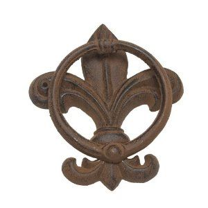 """Cast Iron Fleur de Lis Door Knocker - Brown by Roux Brands. $9.50. Welcome guests with an old world flair by featuring this cast iron door knocker on your front door. Pairs perfectly with our cast iron doormat! 6.25""""high."""