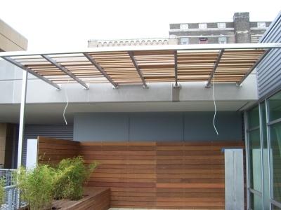 Modern wood awning sun shade pinterest patio patio for Tordos para patios