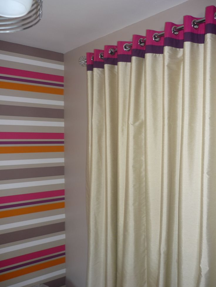 Eyelet headed striped lounge curtains....made to co-ordinate with client's wallpaper!