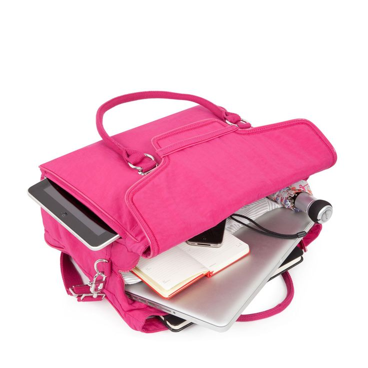 The spacious Kipling City Bag is 100% ready for action! Super handy for your laptop, iPad, mobile and it even has a seperate umbrella compartment! Love it! Have it!