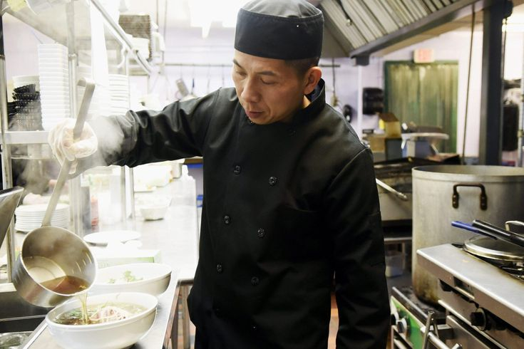 Phan Nguyen, head chef and co-owner of Gigi's Restaurant, pours broth over a combination noodle dish with beef brisket, meatballs and thinly sliced steak. A husband-and-wife team with a background in catering has turned their passion for food into health-conscious Asian cuisine for the local community. Wicked Local Staff Photo/ Sam Goresh