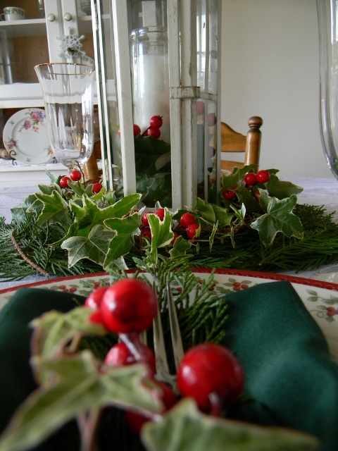 M Cleveland's Holiday Tablescape utilizing leland cyprus, ivy, holly leaves and faux red berries.