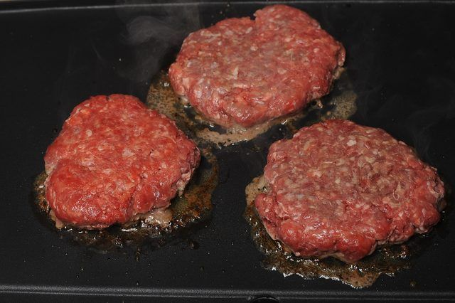 Cooking hamburger indoors on a temperature-controlled electric griddle saves the range top for cooking side dishes while it prepares the meat without added
