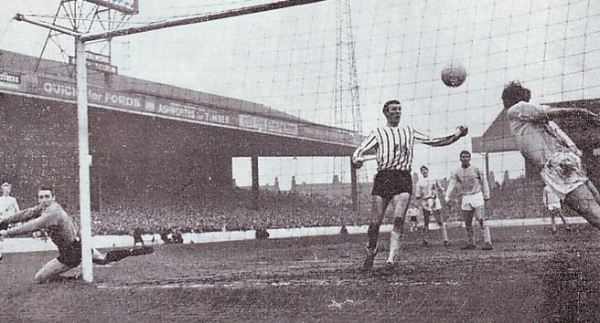 Man City 2 Grimsby Town 0 in Feb 1966 at Maine Road. Cliff Sear heads off the line for City as Grimsby threaten in the FA Cup 4th Round.
