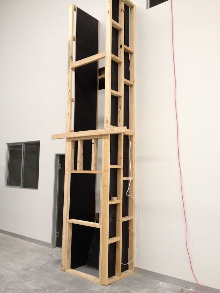 The dumbwaiter travels in a shaft and this is what they look like before being enclosed.