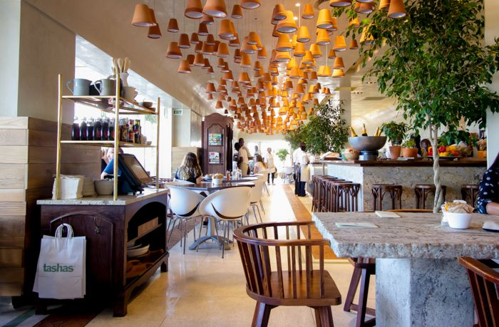 We love the overall effect where tashas V&A Waterfront in Cape Town pairs Spanish terracotta and granite features. Get your granite and marble surfaces at www.rudischoice.co.za for South African and Zimbabwean installations.