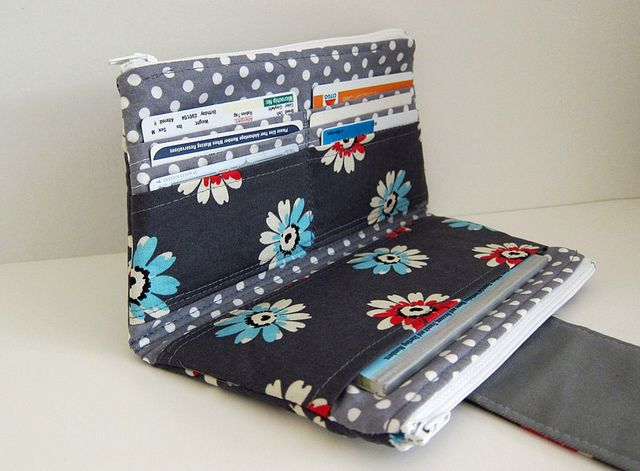 Dual pocket wallet clutch ~~6 Card slots, checkbook or passport pocket, 2 zipper compartments, 4 inner card pockets -- fully padded including the flap with magnetic closure.  Works as a purse organizer also.                                           ..