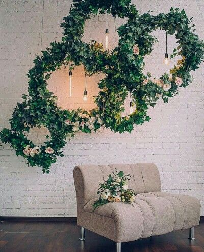 These circles of greenery are pretty cool, and not the burlap/Mason jar look everyone has done for 4 years...