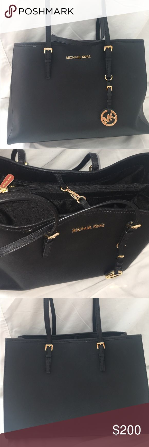 Black Michael Kors Saffiano Leather Jet Set Tote New without tags, light scratches on bottom hard ware from sitting on rough surface, unnoticeable. paypal/apple pay preferred. make and offer!! i cant say yes if you dont ask!!😊 Michael Kors Bags Totes