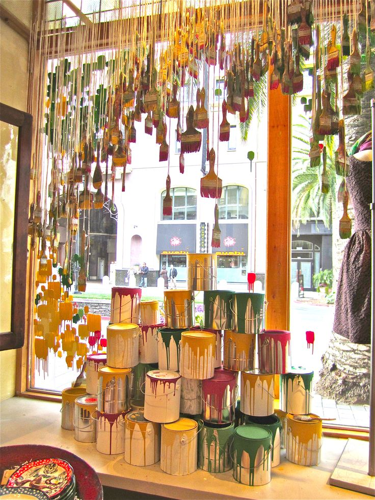 Anthropologie window, Santana Row instead of paintbrushes hang pegs or bridges More
