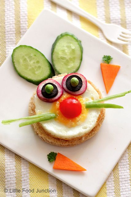 Easter rabbit sandwich (Whole wheat  bread cut into circle  with a sunny side up egg , sliced  red radish, olives, cucumber ,peas, cherry tomato , beans , carrot & parsley. )