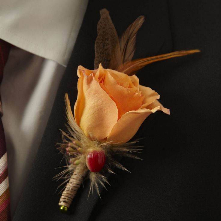 There's even a boutonniere to match our Free Spirit Bouquet, which features a single orange rose with red hypericum berries and seeded eucalyptus.