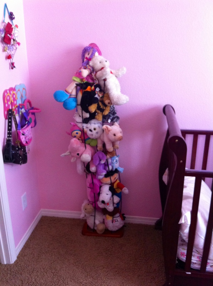 Wire CD tower repurposed as a stuffed animal holder. Love this, it saved a ton…