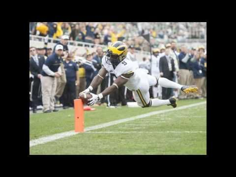 Michigan 32 Michigan State 23   Amara Darboh caught eight passes for a career-high 165 yards and DeVeon Smith ran for two touchdowns to lift No. 2 Michigan to a 32-23 win over rival Michigan State on Saturday.  The Wolverines (8-0 5-0) scored every time they had the ball in the first half beating the Spartans (2-6 0-5) for only the second time in the last nine meetings. Michigan avenged last years loss to Michigan State in which the Spartans scored the winning touchdown on the final play…