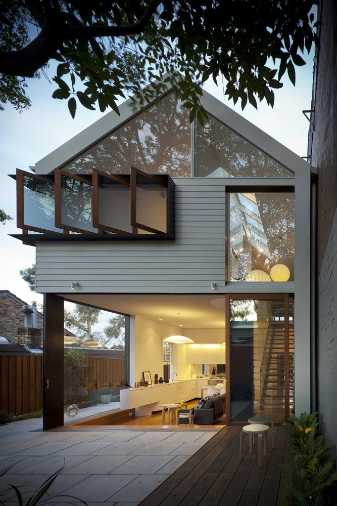Fold-out windows, glass walls, clean lines // revitalizing an old house into a modern space