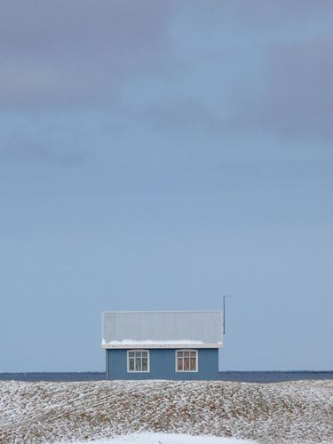 Blue house by the sea