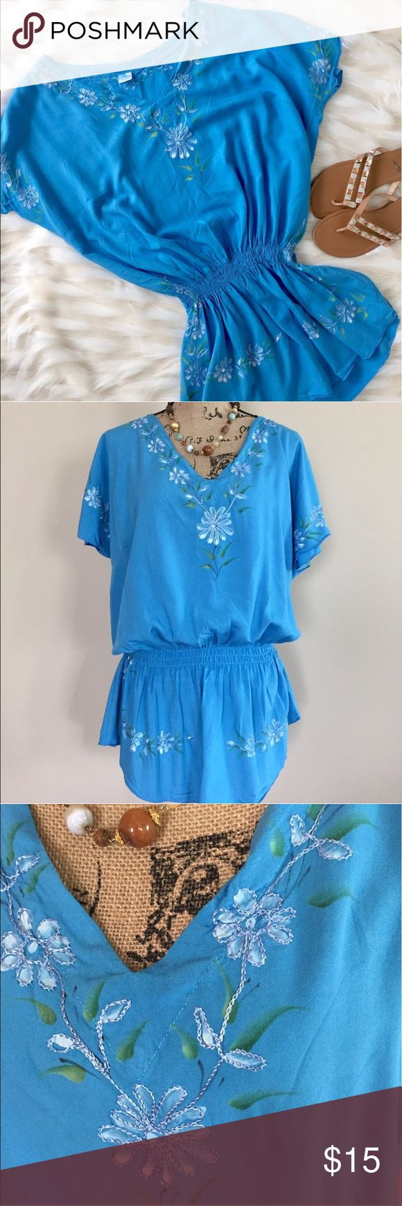 """Turquoise swim cover up Tropical turquoise coverup from a boutique in Punta Cana has a v neckline, loose short dolman sleeves, and an elasticized waist creating a blouson shape. Floral print accent with embroidery. One Size. 100% rayon. Bust measures 23"""" flat, waist 21"""" comfortably stretched, length 32"""".  ⭐️ Swim Coverups"""