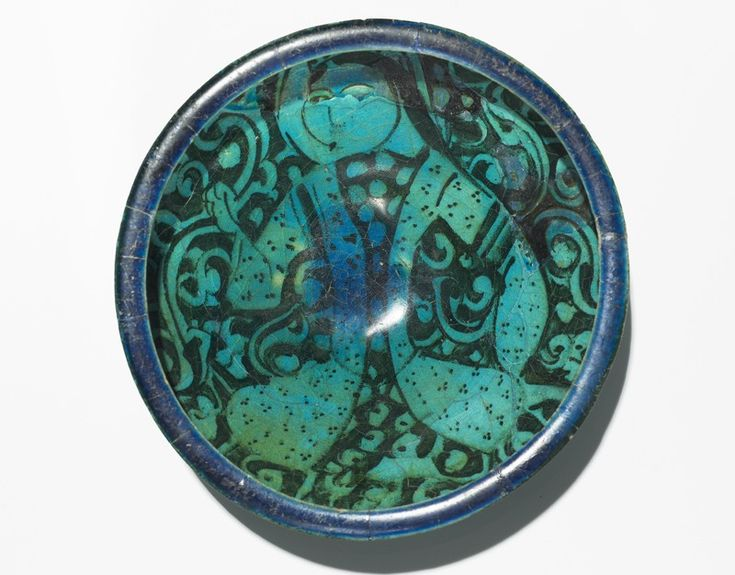 Bowl with seated figure, Iran, Ilkhanid Period (1256 - 1353), fritware under a turquoise glaze