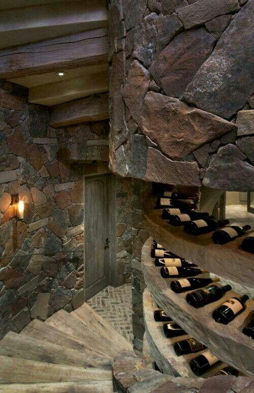 Wine cellar w/spiral stairs plus built-in wine bottle inserts